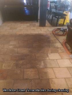 Westleton Crown Terracotta floor tile partially cleaned